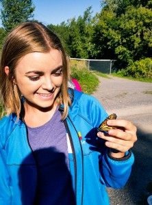 Here is a photo of me right after I caught a Monarch Butterfly, right here in Kingston! Me and my classmates tagged them with a number. But do not worry, we set them free because we want to track their migration down south to Mexico.